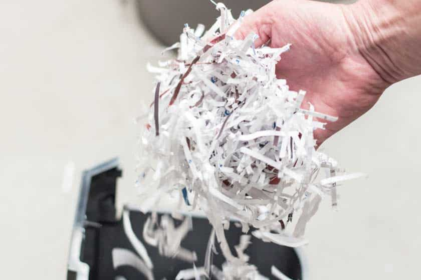 hand-full-cross-cut-shredder-particles
